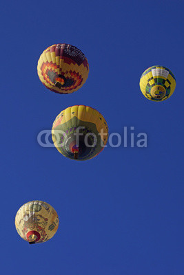 Balloons fill the air over wine vineyard during 2015 Temecula Balloon Festival in California