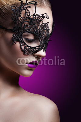 beautiful woman in a black mask. carnival mask Close-up female portrait.