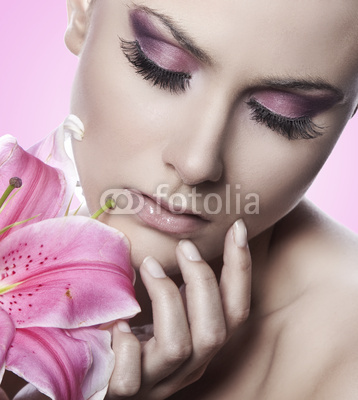 beautiful young sexy woman with flowers on pink background