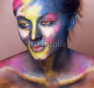beauty woman with creative make up like Holy celebration in India closeup