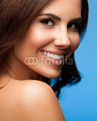 beautiful smiling woman, on blue