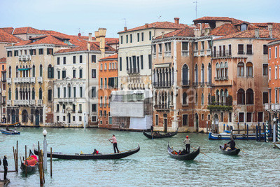 Water canal with gondolas in Venice