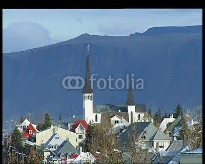 Reykjavik, Iceland: General views of the rooftops of Reykjavik with steep imposing mountains in the background.