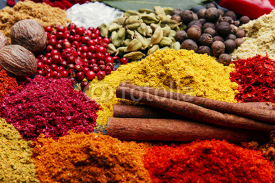 assortment of spices seasoning on a black stone