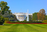 The White House in Washington DC under a clear blue sky.