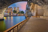 Paris. Image of the Notre-Dame Cathedral and riverside of Seine river in Paris, France.