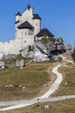 Beautiful medieval castle at sunny day over blue sky, Bobolice,