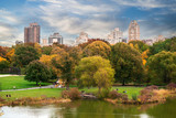 New York City Manhattan Central Park panorama with autumn lake with skyscrapers and colorful trees..