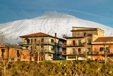 Bronte town under the snowy volcano Etna