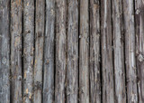 Old logs, ethnic wall of the house.