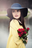 Beautiful Lady with Red Roses Flowers Outdoors