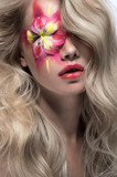 Blonde girl with flower on eye
