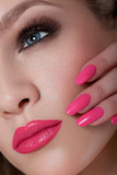 Beautiful Woman With Pink Nails and Luxury Makeup. Red Sexy Lips