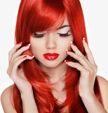 Beauty portrait. Beautiful girl with red long hair. Manicured na