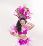 Beautiful samba dancer wearing pink costume and posing