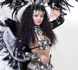 Samba dancer wearing traditional black costume and posing