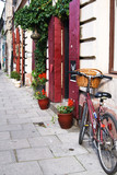 Krakow, Poland - July 12: old red bicycle  standing on a street
