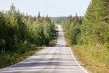 Country road in Lapland, Finland, on a sunny summer day