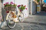 Tourist bike with flowered wicker basket along the streets of Ortigia, the old Syracuse