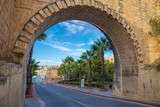 The arch of Valletta with palm trees and blue sky - Malta