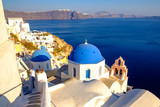 Scenic view of beautiful white houses and blue dones, Santorini