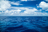 blue ocean background with blue cloudy sky