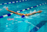 young male athlete swimmer swims at competitions butterfly
