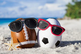 Sport eggs with sunglasses on ocean beach –easter symbol