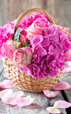 beautiful pink roses and hydrangea in basket