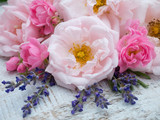 Pink roses and lavender bouquet on the rustic background