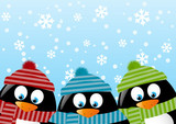 Cute penguins on winter background