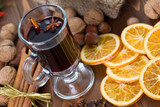 Mulled wine, cinnamon sticks, nuts and dried orange slices