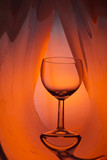 Wine glass on an abstract colored background