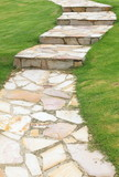 Natural sand stone pathway and green grass