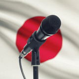 Microphone on stand with national flag on background - Japan