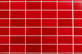 A red tiled background with relatively small tiles