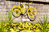 Yellow bicycle exposed on York city walls, England