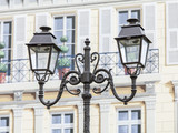 NICE, FRANCE - on JANUARY 11, 2016. Architectural details. Ancient streetlight