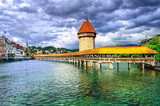 Lucerne, Switzerland, medieval wooden Chapel bridge over Reuss river and Water tower