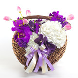 Beautiful flowers in basket isolated.