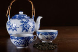Old Chinese porcelain teapot with two cups