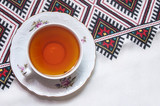 porcelain cup of tea on the tablecloth