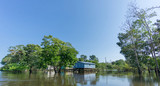Woode houses built on high stilts over water, Amazon rainforest