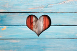 Love Peru. Heart and flag on a blue wooden board