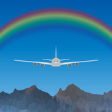 Plane flying over blue sky with rainbow over high mountains