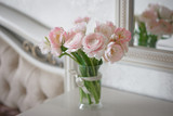 bouquet of delicate ranunculus and tulips in interior