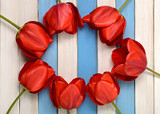 bouquet of red tulips and colorful wooden strips