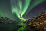 Incredible Aurora Borealis over night sky in Arctic