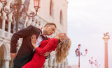 Romantic couple dancing on the street in Venice
