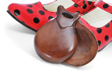 spanish castanets and typical dot-patterned red flamenco shoes